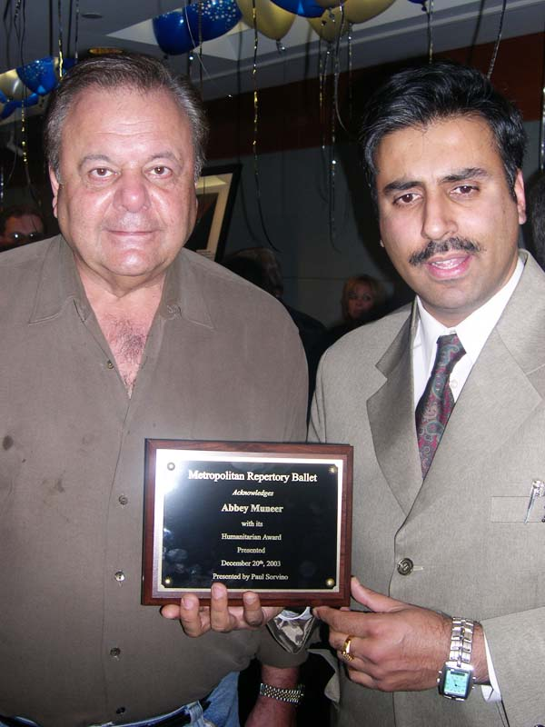 Dr.Abbey recieving Award from Paul Sorvino @ Lincoln Ctr 2003
