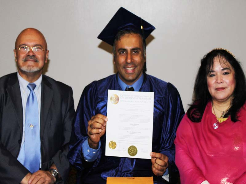 Dr.Abbey with Dr Fernadnez & Haddasa Holding up Phd Degree