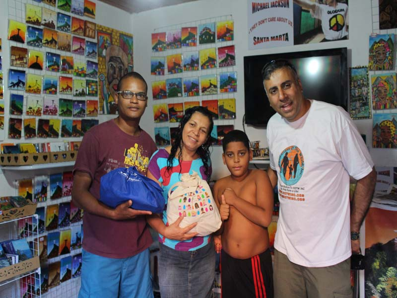 Dr.Abbey Presenting to a Needy Family in the Favela