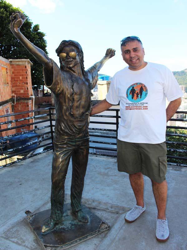 Dr.Abbey with Michael Jackson Statue at Santa Marta Favela