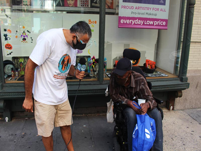 Dr Abbey Giving Bag to willie Homeless and disabled