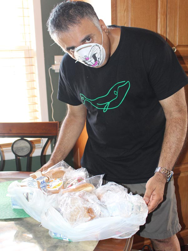 Dr Abbey packing bags of food on daily basis for homeless