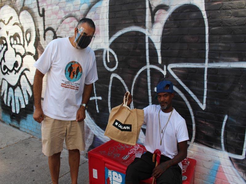 Dr Abbey presenting bag to Mr C Homeless Veteran