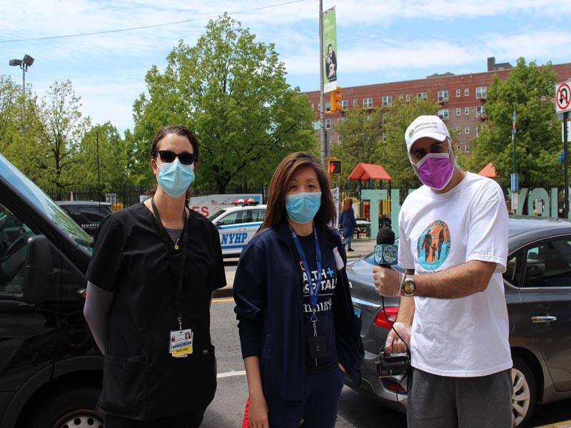 Dr Abbey with Elmhurst Hospital Nurses