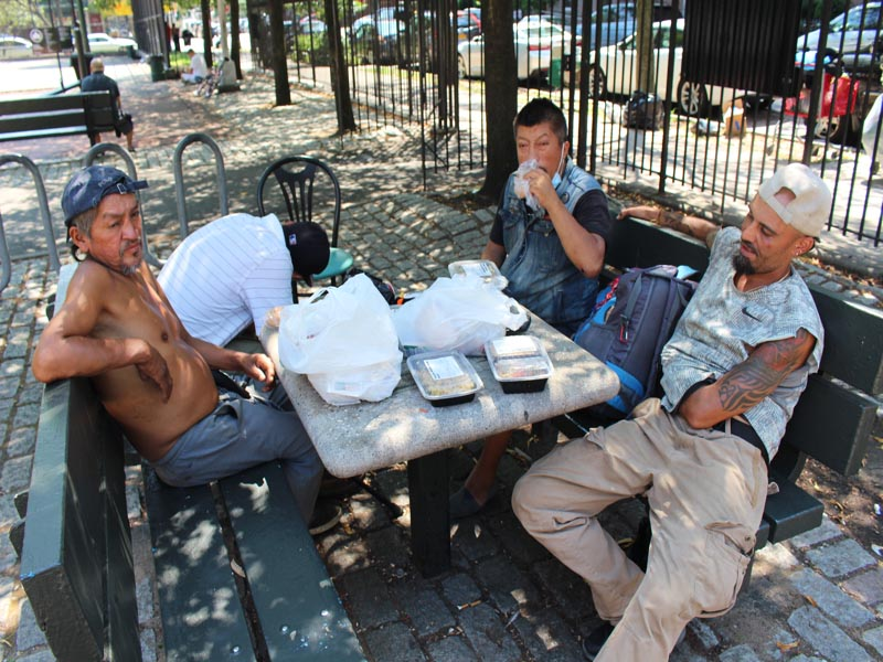 Homeless Jose with Pedro and Juan recieving food frm HOTWINC