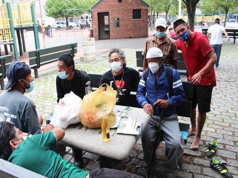 Hotwinc org Voluteers giving food bags to South American Homeless on a daily basis