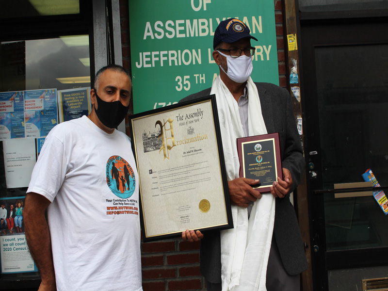 Dr.Abbey with Assembly Member Jeffrion L.Aubury Presenting Proclamation