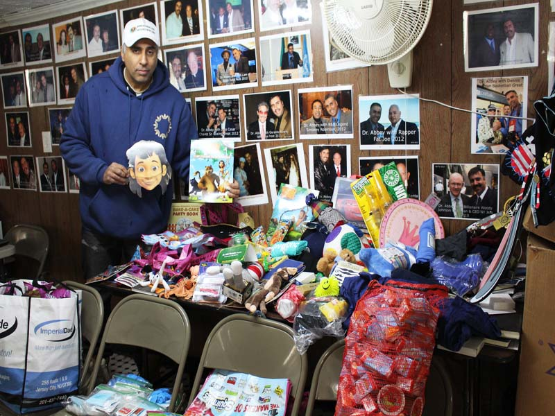 Dr.Abbey packing Toys for needy kids