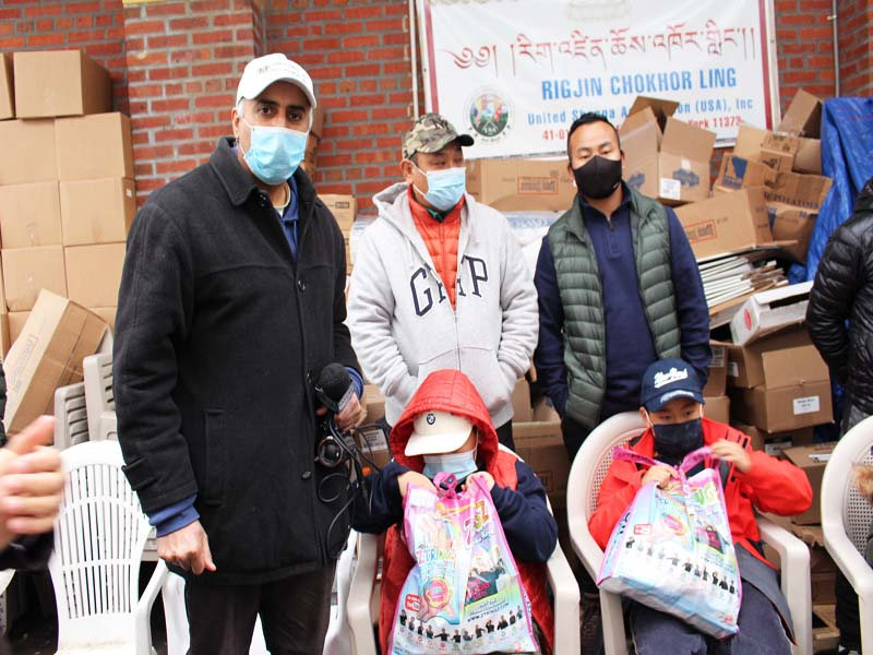 Dr.Abbey presenting bags of Toys and Food to 2 Himalayan Families